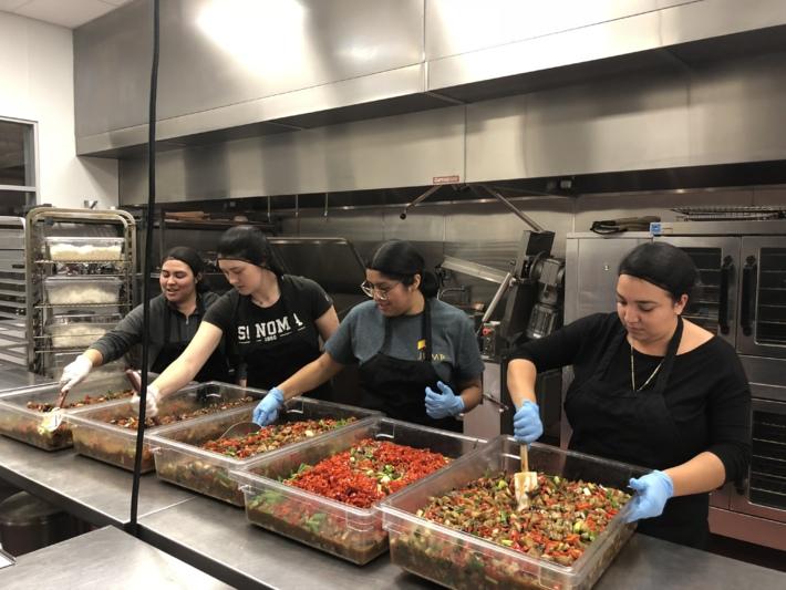 Students serving food at a food bank